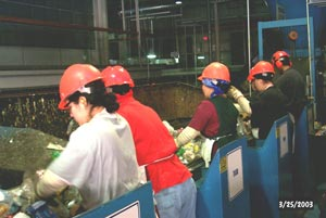 Workers at the Light Item Sort Station