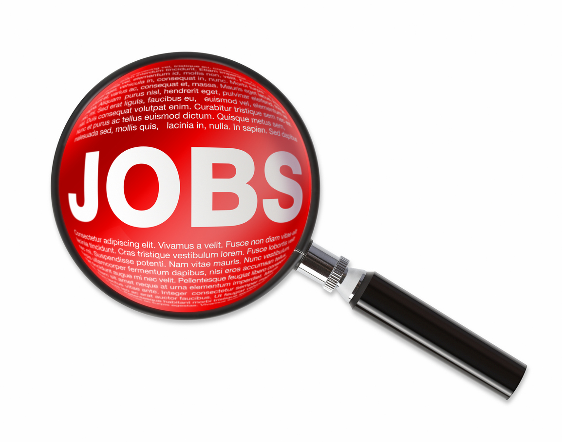 Magnifying glass revealing JOBS text