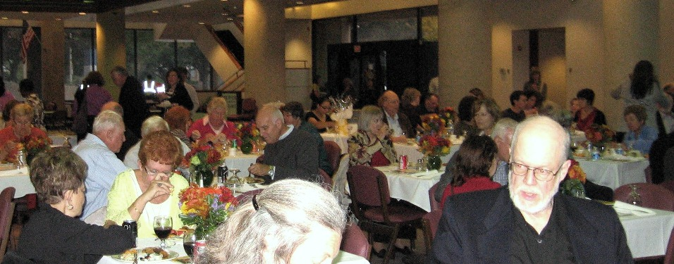 More than 130 invited guests enjoy a light dinner in the EOB cafeteria at the annual Beautification Award Ceremony
