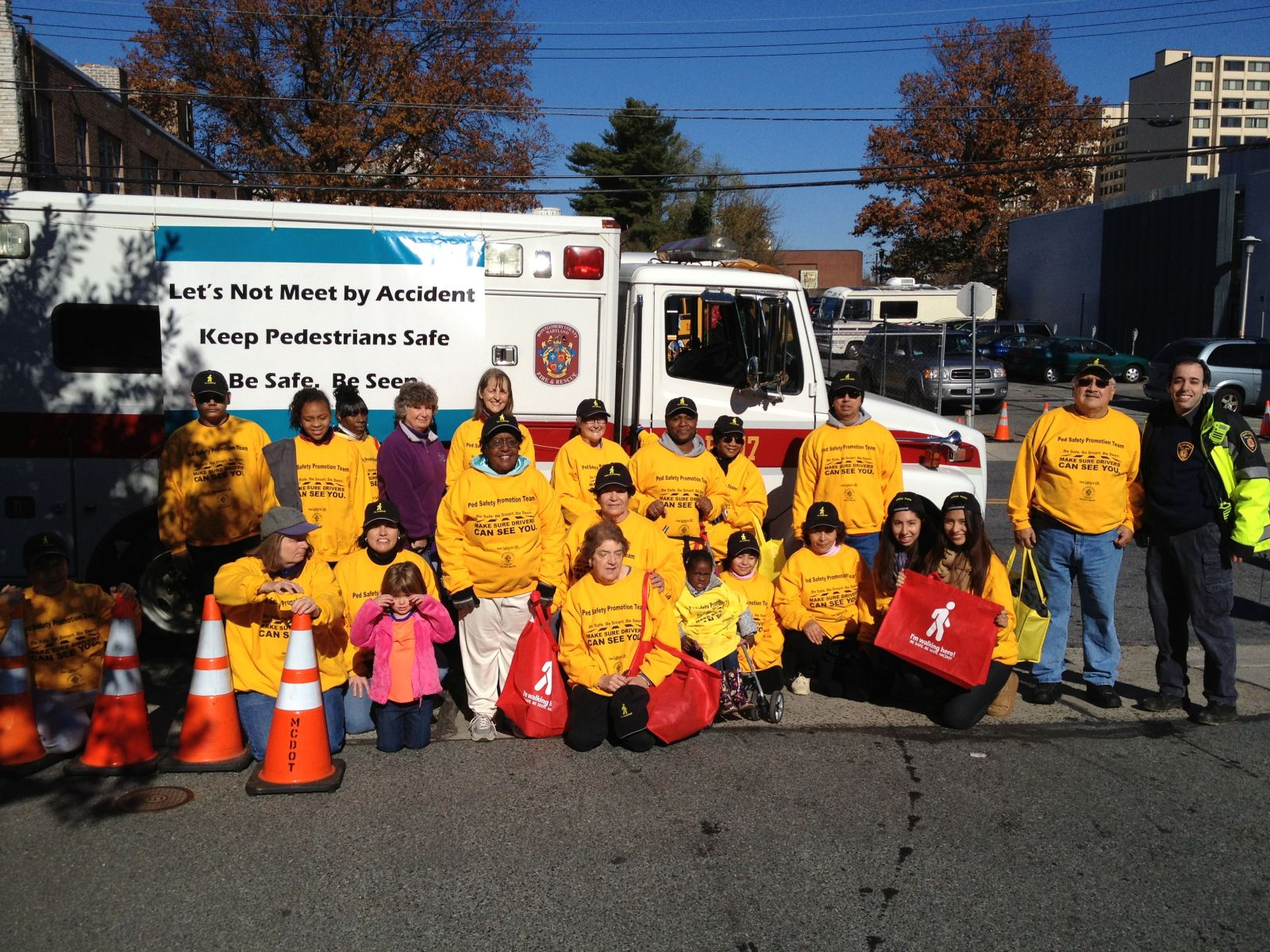 Photo of pedestrian safety volunteer team and Silver Spring Fire Rescue ambulance at 2012 Montgomery County Thanksgiving Parade
