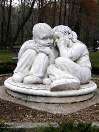A cast stone sculpture called Whispers by Steve Weitzman