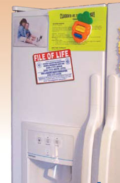 Refrigerator with File of Life packet on it