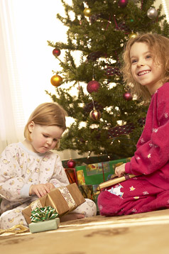 Holiday Safety photo of two kids and Christmas tree