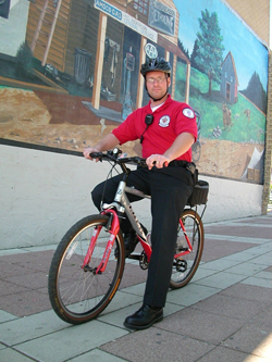 Redshirt member riding bike