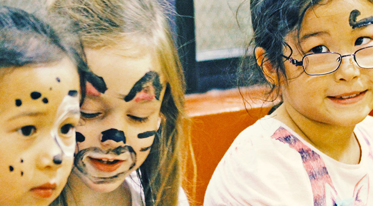 Three girls with painted faces
