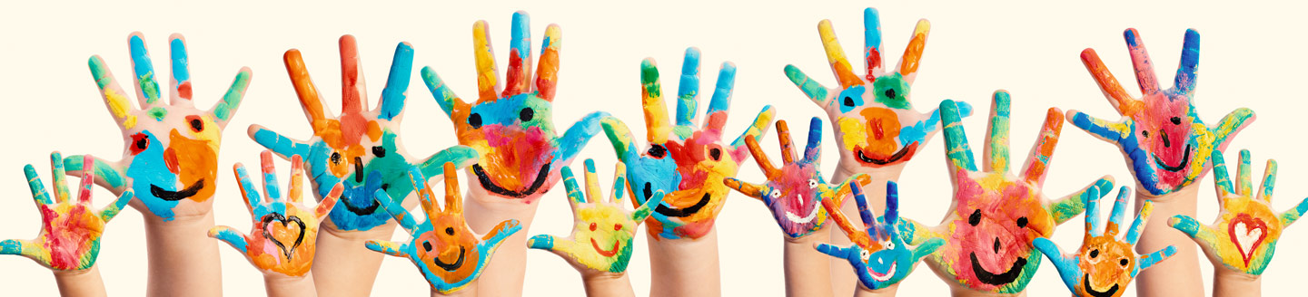 painted hands with smile faces