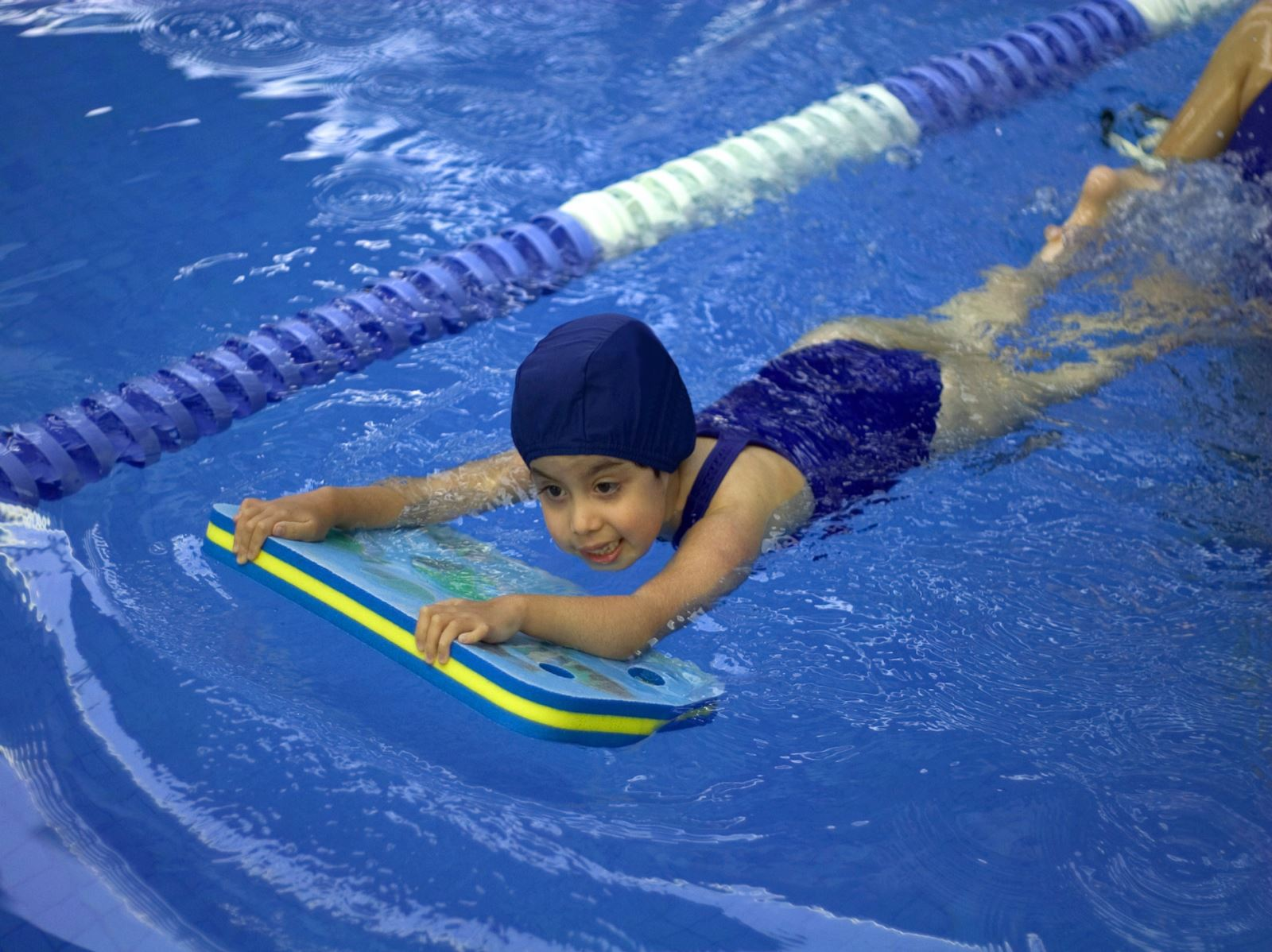 girl swimming with board