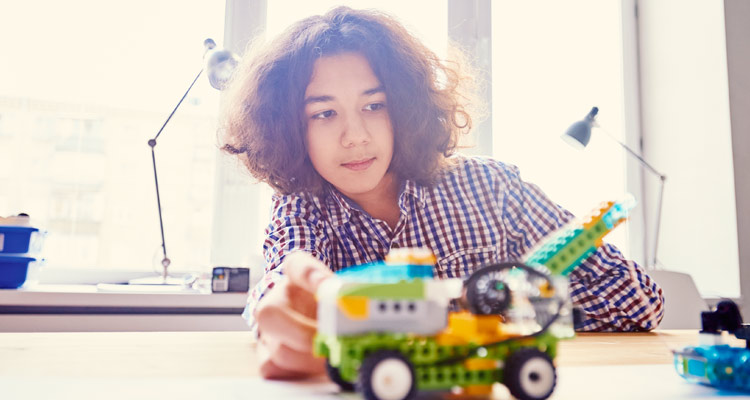 boy with robotic lego creation