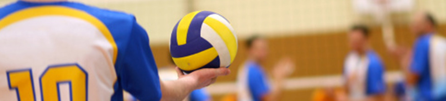 volleyball player about to serve the ball